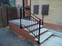 outdoor steps with metal rail