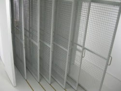 Floor supported Art Racking on brass track for soft and smooth extraction.